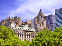 New york city office buildings exterior. Tall modern office buildings exterior against blue sky in New York street United states Royalty Free Stock Photography