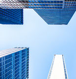 New York City office buildings. New York City skyscraper in front of bright blue sky Royalty Free Stock Image