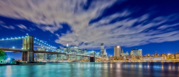 New York City Panoramic at night. Wide angle view of New York Financial District and Brooklyn Bridge Stock Photo