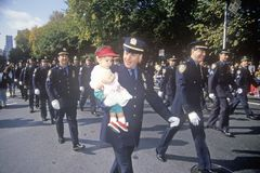New York City Police Officer with child at Columbus Day Parade, New York City, New York Stock Image