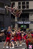 New York City Pride Parade - Adult Cheer Team. The New York City Pride Parade celebrating all lifestyle choices. Cheer New York performing high aerial maneuvers Stock Photography