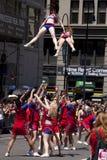 New York City Pride Parade - Adult Cheer Team. The New York City Pride Parade celebrating all lifestyle choices. Cheer New York performing high aerial maneuvers Stock Photos