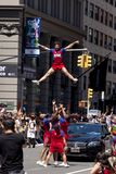 New York City Pride Parade - Adult Cheer Team. The New York City Pride Parade celebrating all lifestyle choices. Cheer New York performing high aerial maneuvers Royalty Free Stock Image