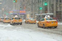New York City radio city in snow winter slushy. New York City radio city in snow cold cars sorbets Stock Images