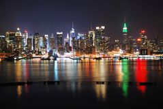 New York City with reflections. New York City night skyline panorama over Hudson river with boat and skyscraper and colorful reflections Royalty Free Stock Photos