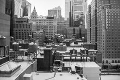 New York city rooftops covered with snow. Rooftops and watertanks on New York city buildings all covered with snow Royalty Free Stock Photos
