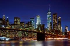 New York City& x27;s Brooklyn Bridge and Manhattan skyline illuminated Royalty Free Stock Photography