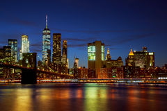 New York City& x27;s Brooklyn Bridge and Manhattan skyline illuminated Stock Images