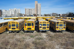 New York City school buses on parking lot. A New York City school buses. In the United States, school buses provide an estimated 10 billion student trips every Royalty Free Stock Photo