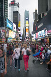 New york city, 12 september 2015: many people enjoy themselves o. N crowded broadway in new york city near times square royalty free stock images
