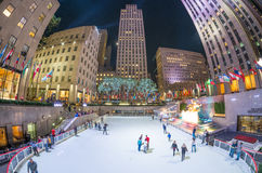 NEW YORK CITY - SEPTEMBER 2015: Tourists and locals enjoy Ice Ri. Nk in Rockefeller Center. The city attracts 50 million people annually royalty free stock images