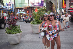 New york city, 12 september 2015: two girls in bikini play guita Royalty Free Stock Photos