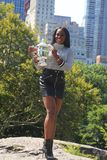 US Open 2017 champion Sloane Stephens of United States posing with US Open trophy in Central Park. NEW YORK CITY - SEPTEMBER 10, 2017: US Open 2017 champion Royalty Free Stock Photo