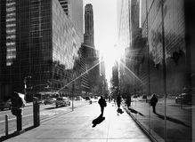 New York city sidewalk. Abstract New York city sidewalk with commuters walking towards strong morning sunlight