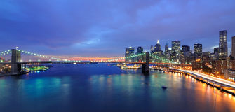 New York City Skyline. Skyline of Manhattan and Brooklyn Bridge spanning the East River at twilight in New York City Royalty Free Stock Photos