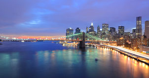 New York City Skyline. Skyline of Manhattan and Brooklyn Bridge spanning the East River at twilight in New york City Royalty Free Stock Photo