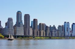 New York City skyline. The Skyline of New York City, New York, USA with sailing boat Stock Photos