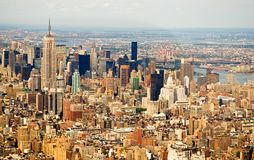 New York City skyline. An aerial view of the buildings of mid-town Manhattan, New York City, New York, including the Empire State Building Royalty Free Stock Image