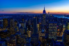 Free New York City Skyline At Night - Skyscrapers Of Midtown Manhattan With Empire State Building At Amazing Sunset - USA Stock Photography - 144394102