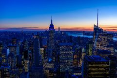 Free New York City Skyline At Night - Skyscrapers Of Midtown Manhattan With Empire State Building At Amazing Sunset - USA Royalty Free Stock Image - 144394136