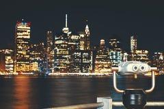 New York City skyline with binoculars at night, USA. Royalty Free Stock Photo