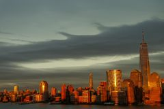New york city skyline daytime sun clouds stock photo