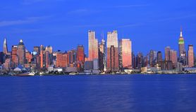 New York City skyline at dusk, view from New Jersey area. New York City skyline including The Empire State Building colorful illuminated at dusk with Hudson stock images