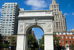 New York City skyline and Empire State Buiiding. The Empire State Building as seen through the arch in Washington Square Park in New York City Royalty Free Stock Photos