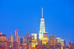 New York City skyline. Of financial business buildings in Manhattan illuminated at night Stock Images