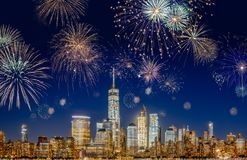 New York City Skyline with Flashing Fireworks - long exposure. New York City Skyline with Flashing Fireworks - A night long exposure of New Years Eve Celebration stock image