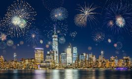 New York City Skyline with Flashing Fireworks. New Years Eve Celebration. A night long exposure with empty space for text Royalty Free Stock Image