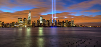 New York City skyline with 9/11 lights in the morning. This is the New York city skyline in the morning before sunrise.  The 9/11 tribute lights are lit to Royalty Free Stock Photos
