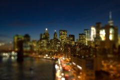 New York City skyline lights at night. With the colorful lights of the downtown skyscrapers with blurred background bokeh effect Royalty Free Stock Photography