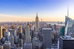 New York City Skyline in Manhattan downtown with Empire State Building and skyscrapers at sunset USA royalty free stock photography