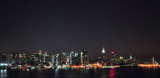 New York City Skyline at night. Shot of new york city with the reflection of the city light on the river Royalty Free Stock Photos