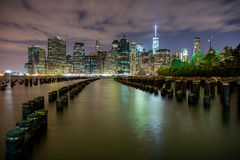 New York City Skyline, Night. The NYC skyline at night with a wide perspective vantage point Royalty Free Stock Images