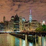 City Skyline, Night. City skyline of New York. Pilings fill the waterfront Stock Image