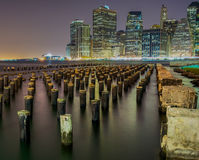 New York City, Perspective. New York City Skyline at night with the Brooklyn pier vantage point. Downtown and midtown visible Royalty Free Stock Photography