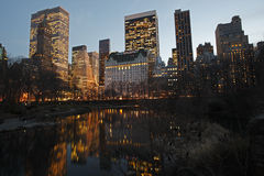New York City Skyline from the Pond. New York City view of the Plaza Hotel and other towers with reflections in the Pond as seen from Gapstow Bridge in Central Stock Photos