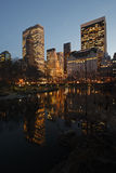 New York City Skyline from the Pond. New York City view of the Plaza Hotel and other towers with reflections in the Pond as seen from Gapstow Bridge in Central Royalty Free Stock Photos