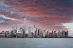 New York City Skyline red sunset. NEW YORK CITY, USA-NOVEMBER 3: Manhattan financial district in New York City on november 3, 2013 Stock Photo