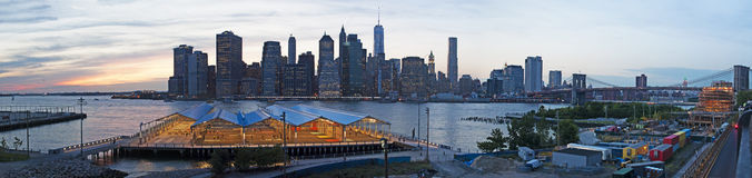 New York City skyline seen from Brooklyn, Brooklyn bridge, East River, skyscrapers, sunset, lights, panoramic view Royalty Free Stock Image