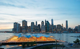 New York City skyline seen from Brooklyn Heights Promenade after sunset, lights Stock Photography