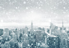 New York City skyline during a snowstorm. NEW YORK, USA - CIRCA 2017: Snowfall in New York City. New York City skyline during a snowstorm. Aerial view over Royalty Free Stock Photo