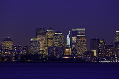 New York City Skyline and Statue of Liberty. At dusk royalty free stock image
