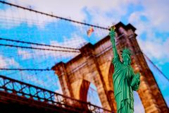 The statue of liberty and Brooklyn Bridge with New York City skyline royalty free stock image