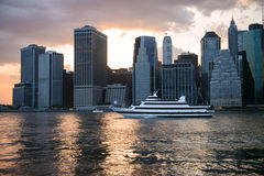 New York City skyline at sunset time and cruise ship with tourists. Royalty Free Stock Images