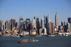 New York City Skyline and Tugboat Royalty Free Stock Photography
