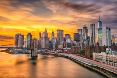 New York City Skyline. New York, New York, USA lower Manhattan skyline over the East River with the Brooklyn Bridge after sunset stock photo