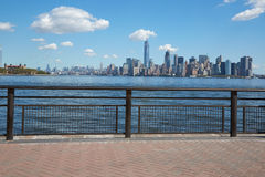 New York city skyline view and Ellis Island from dock terrace Royalty Free Stock Photography